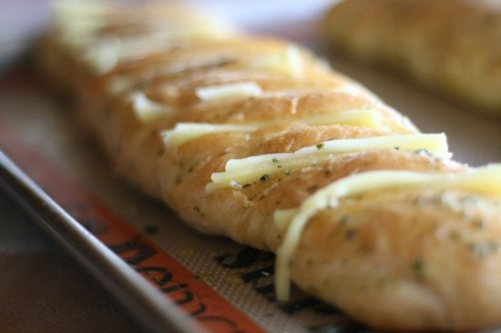 Hasselback Garlic Cheesy Bread... MORE butter, MORE garlic, and MORE bread! It's ridiculously amazing.