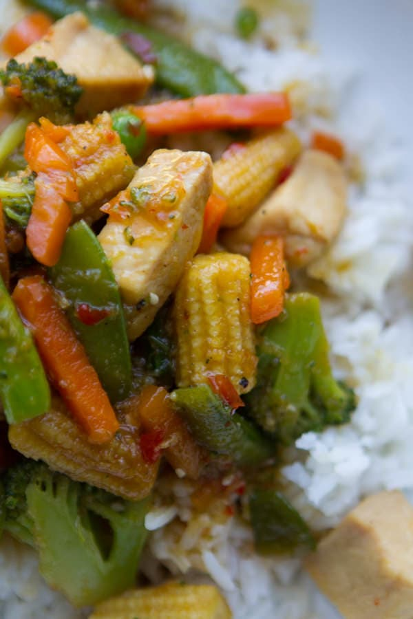 The best Stir Fry ever! Takes 15 minutes to make this and uses *homemade* sweet and spicy stir fry sauce!! Seriously, add this to your weekly dinner rotation!