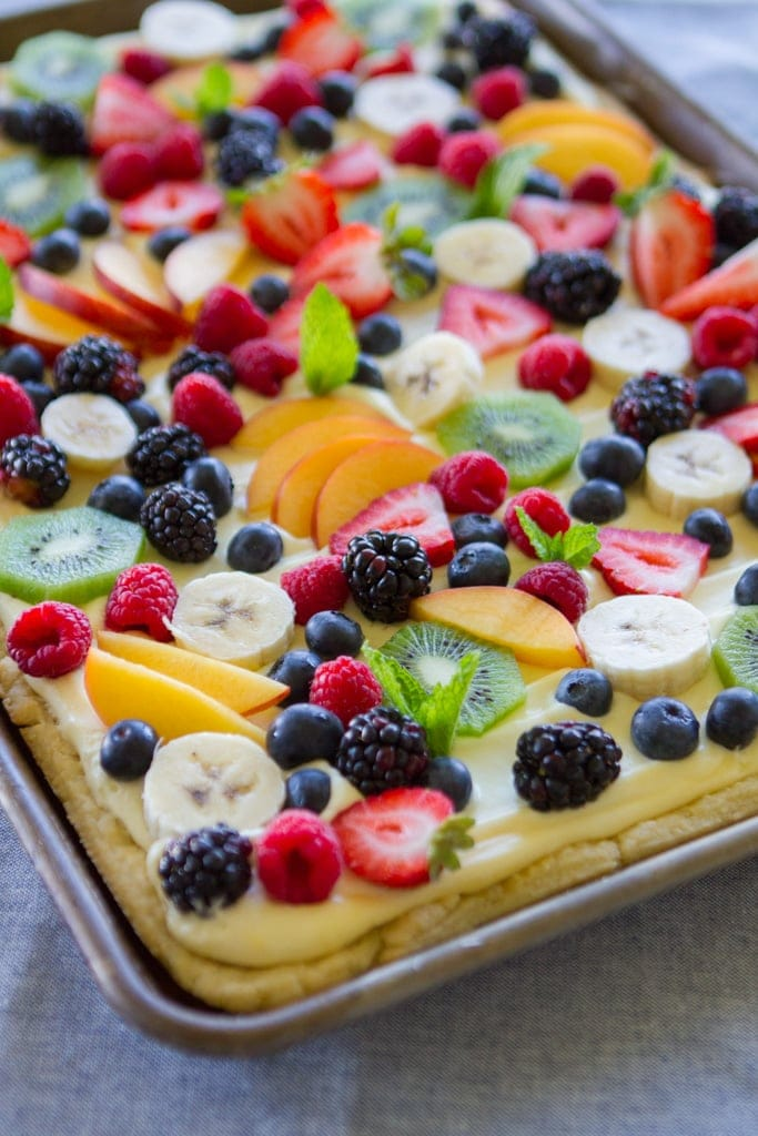Fruit Flan...homemade cream cheese pastry, almond cream filling and fresh fruit!! So much better than dessert pizza!