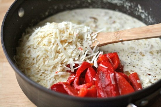 Roasted Red Pepper & Goat Cheese Alfredo... You're seriously going to fall in love with all the creaminess and alfredoness that this dish has going on!