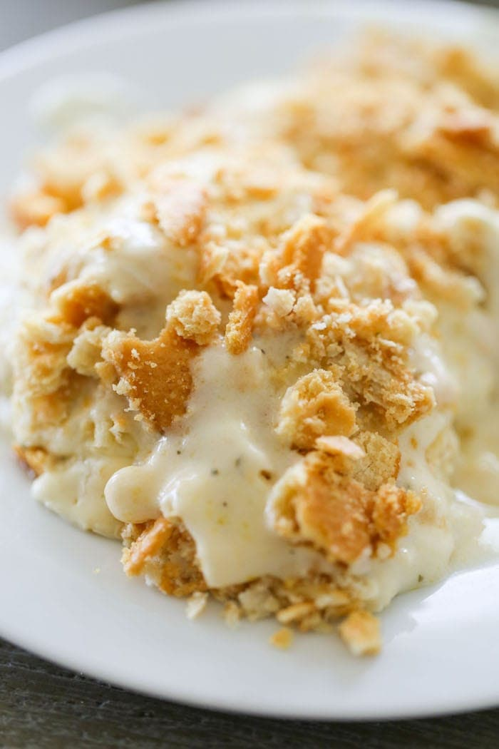 Creamy Ranch Chicken Casserole is cheesy, tangy and easy! Lots of creamy ranch flavor with toasty crackers on top.