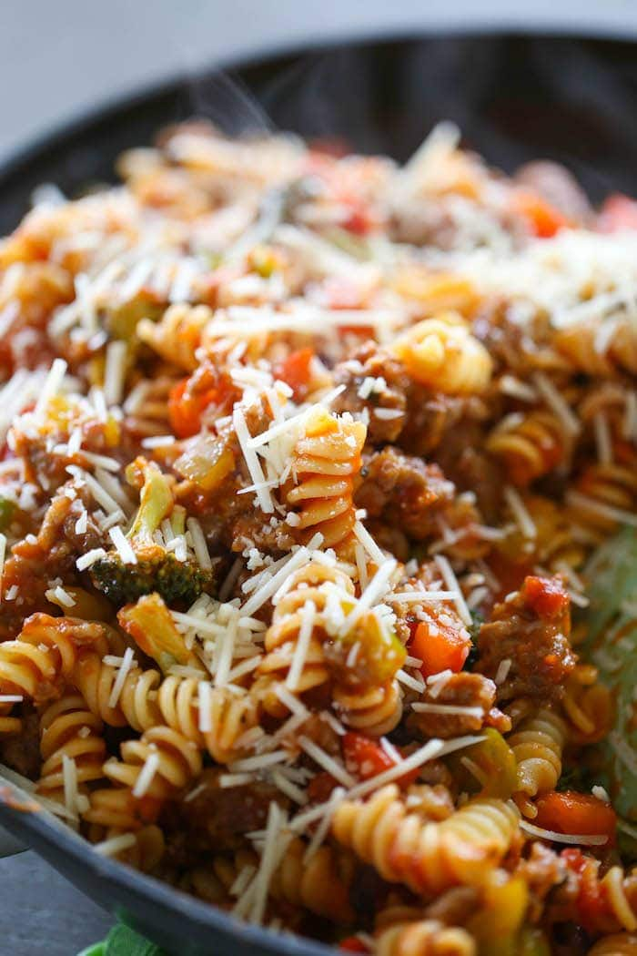 Italian Sausage & Peppers Pasta is an easy weeknight meal for pasta lovers! This dinner is laced with peppers, broccoli, garlic, Italian Sausage and marinara for a yummy and filling meal!
