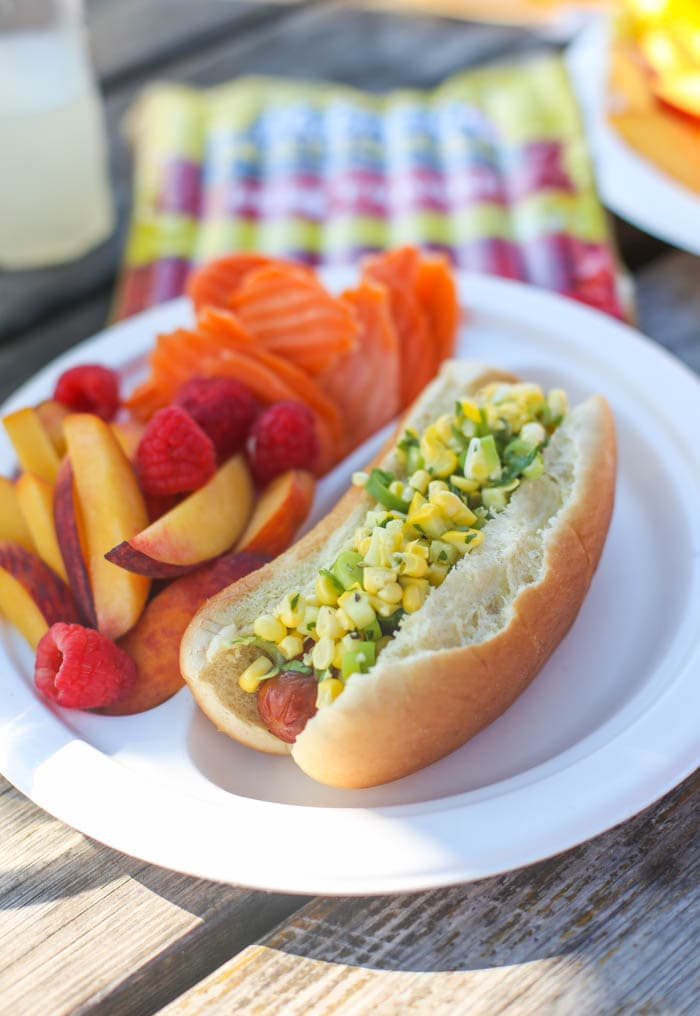 A super-fresh Mexican Corn Salad up on top of a grilled hot dog is the most glorious summer dinner ever. EVER!